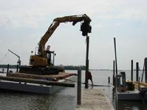 Placing and lining up a piling on this Biloxi Back Bay pier.